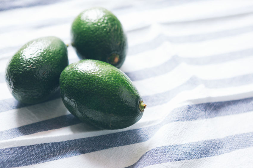 Food And Drink Healthy Eating Food Green Color Wellbeing Freshness Fruit Close-up No People Indoors  Still Life Focus On Foreground Textile Shadow Tablecloth Striped Sunlight Day Avocado Table Ripe Vegetarian Food
