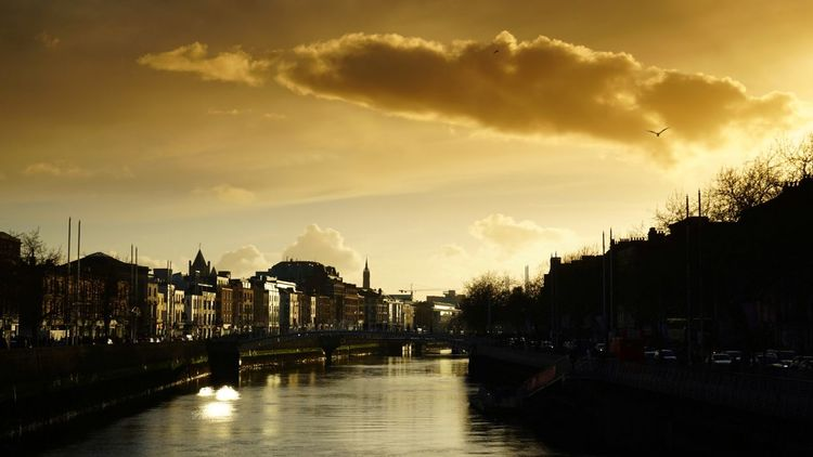 Sun setting over The River Liffey and The Ha'penny Bridge in Dublin, Ireland. Cloud - Sky Travel Destinations Sunset Reflection Sky Outdoors Vacations Night No People Water City Cityscape Architecture Dublin Ireland🍀 Ireland Liffeyriver Ireland Hapennybridge Oconnellstreet Oconnellbridge RiverLiffey Sunsets