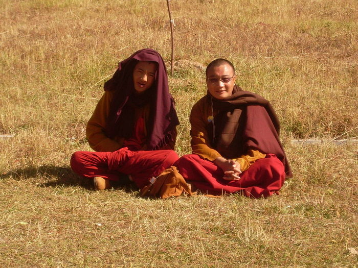 Lama Monks in Wutaishan Shanxi Adult Buddhist Monk Buddhist Monks Day Field Friendship Full Length Grass Hood - Clothing Hooded Shirt Lama Monk Lama Monks Lifestyles Looking At Camera Mammal Outdoors Portrait Real People Relaxation Sitting Togetherness Two People Young Adult Young Men Young Women
