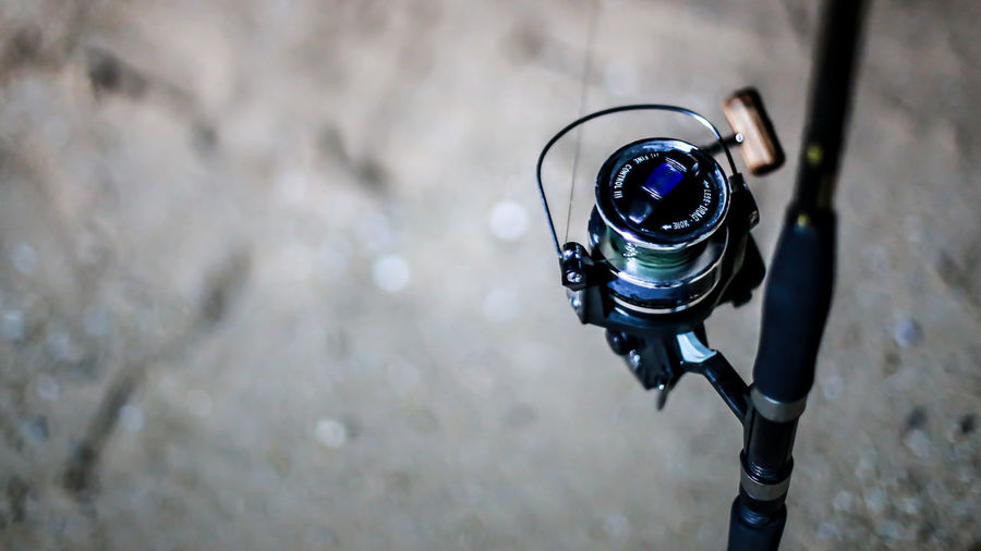 High angle view of camera on bicycle against wall