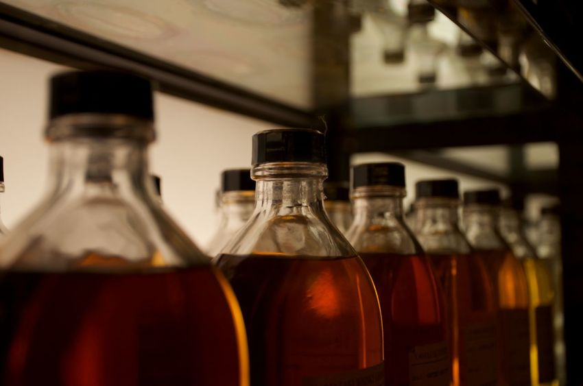 Bottles of different vintages of whiskey line shelves at a famous distillery. Bottle Food And Drink Alcohol No People Focus On Foreground Container Japan Whiskey Travel Destinations Collection Spirits Celebration Libations Personal Collection