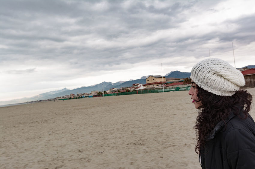 Sisters Adult Adults Only Beach Beauty In Nature Cloud - Sky Day Italy Leisure Activity Nature One Person One Woman Only Only Women Outdoors People Real People Sand Sea Sky Tourism Warm Clothing
