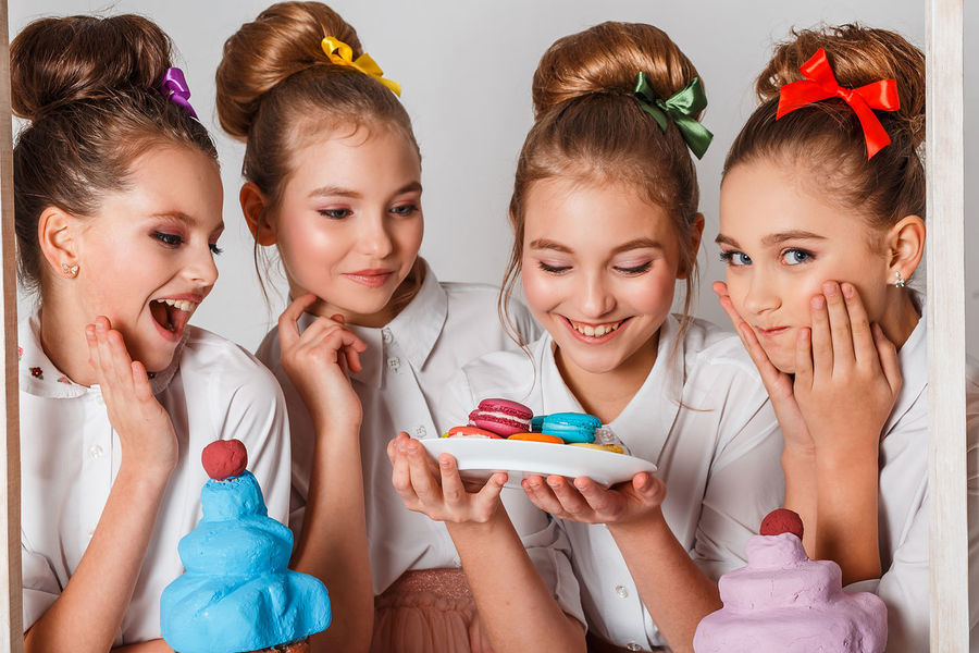 Beautiful teenage model girls in pink tutu or tulle skirts with macaroons, fancy cakes and sweets in studio on white background Beautiful Celebration Fun Macarons Adorable Delicious Party People Selling Smiling Smiling Face Surprising Sweet Food Tasty Teenage Girls