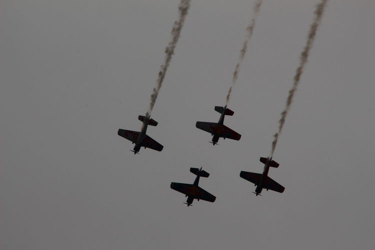 Aerobatics Air Force Air Vehicle Airplane Airshow Arrangement Clear Sky Day Fighter Plane Flying Formation Flying Low Angle View Mid-air Military Airplane No People Outdoors Plane Sky Speed Teamwork Transportation Vapor Trail
