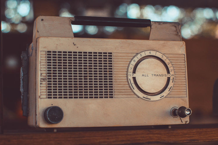 Close-up of vintage radio on table