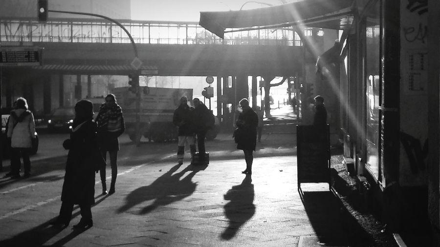 Silhouette people walking in corridor