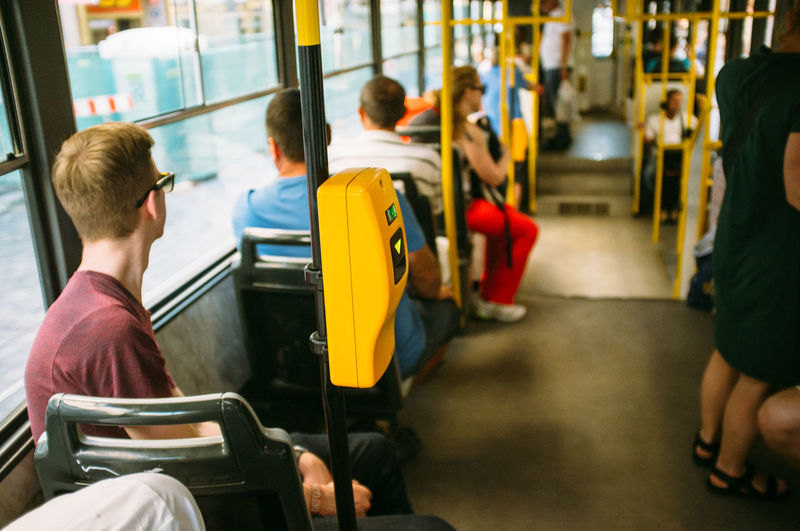 Young man traveling in bus