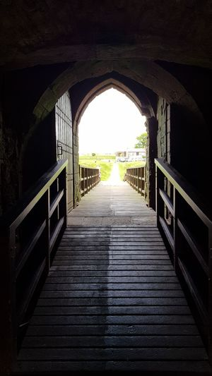 The Way Forward Day Built Structure No People Architecture Indoors  Light Beam Sunlight Taking Photos Taking Pictures The Great Outdoors - 2017 EyeEm Awards Showcase May 2017 Through The Gateway Castle View  View From Castle Doorporn Door Way To Freedom Doorway Draw Bridge Looking Out Way Out In  Tunnel Of Light TunnelPorn Tunnel View Tunnel Vision