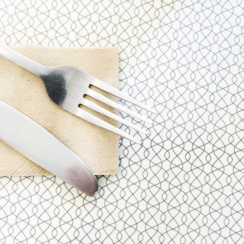 High angle view of fork and table knife on table