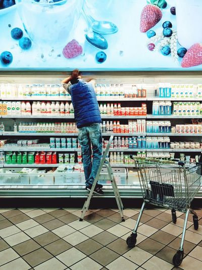 Supermarket Full Length Retail  Store One Person Indoors  Real People Adults Only Only Women Adult Day One Woman Only People Working Kiev Ukraine Things Organized Neatly Yoghurt This Is Masculinity