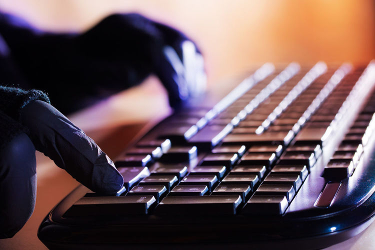 Cropped Hands Of Person Typing On Computer Keyboard