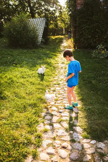 Boy standing in a grass