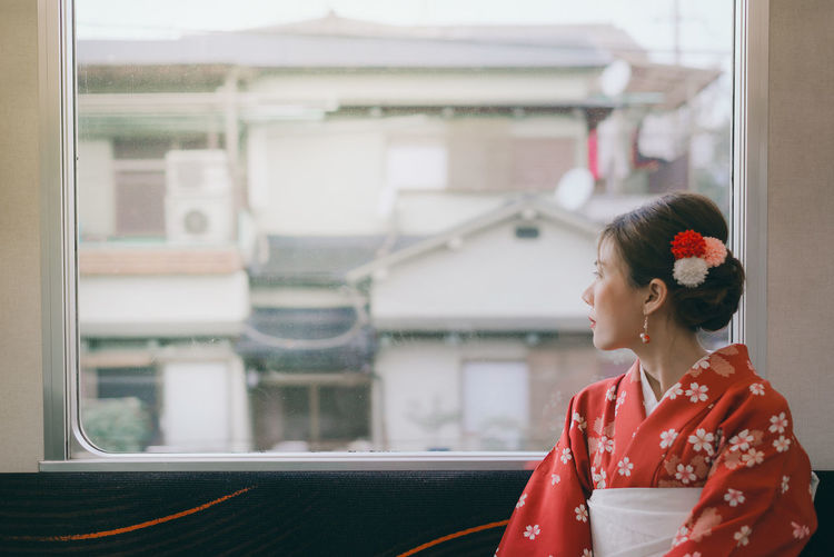 Asian woman wearing kimono traveling by the japan classic train sitting near the window Women Architecture Lifestyles Looking Leisure Activity Young Women Standing Window Red Young Adult Day Focus On Foreground Looking Away Clothing Hairstyle Outdoors Kimono Japan Woman Train Sad Depression - Sadness City Japanese  Unban International Women's Day 2019