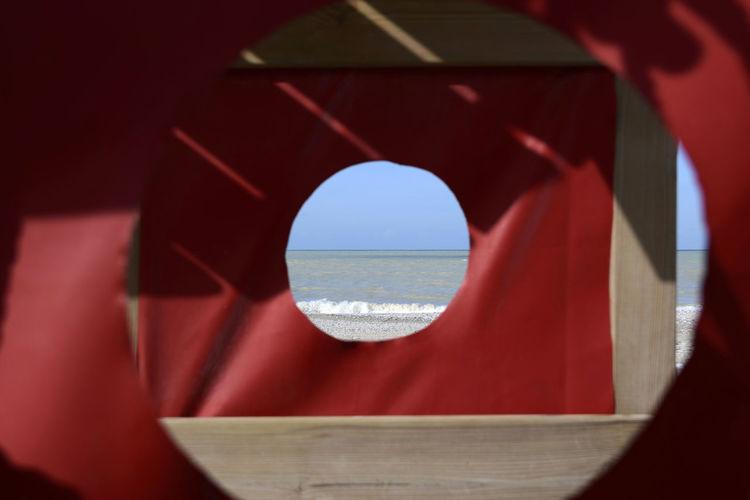 sea in a hole Seascape No People Waves Hole Plastic View From A Hole Adriatic Sea Coast Beach Winter Shape Circular Shadows