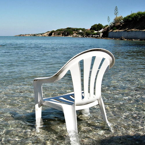 Absence Beach Beauty In Nature Chair Clear Sky Day Empty Land Nature No People Outdoors Sea Seat Sky Sunlight Tranquil Scene Tranquility Water