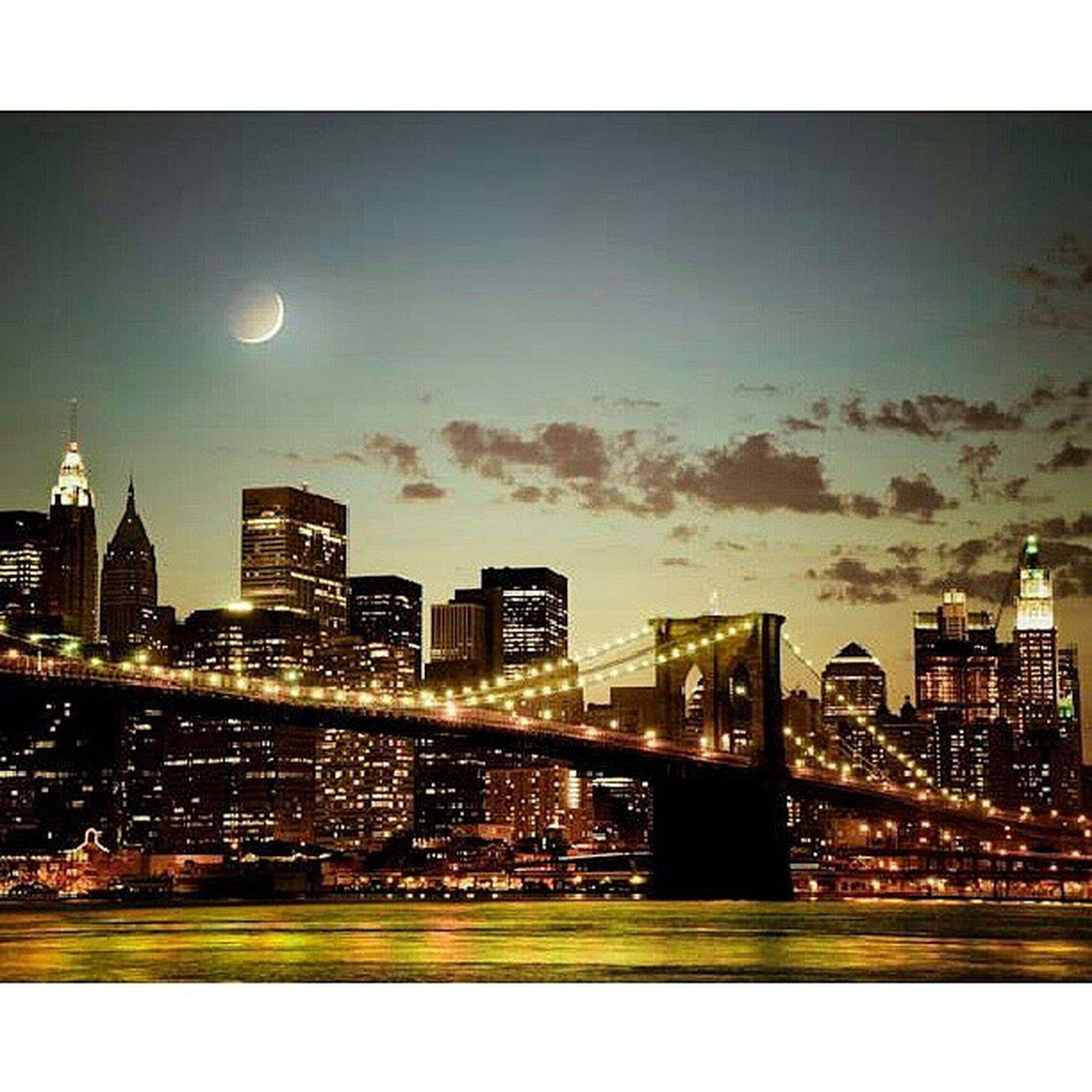 illuminated, architecture, city, built structure, cityscape, building exterior, night, transfer print, auto post production filter, sky, river, skyscraper, water, modern, city life, moon, connection, waterfront, bridge - man made structure, urban skyline