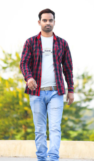 Man standing in a highway Casual Clothing One Person Young Men Front View Young Adult Standing Portrait Real People Looking At Camera Three Quarter Length Day Focus On Foreground Lifestyles Beard Leisure Activity Facial Hair Cool Attitude Handsome Outdoors Jeans