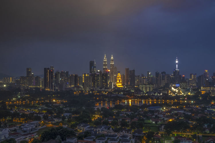 A view of Kuala Lumpur, capital city of Malaysia with lake in front of it during blue hour Kuala Lumpur Malaysia  Tasik Titiwangsa Architecture Building Building Exterior Built Structure City Cityscape Cloud - Sky Financial District  Illuminated Modern Nature Night No People Office Building Exterior Outdoors Residential District Sky Skyscraper Tall - High Urban Skyline