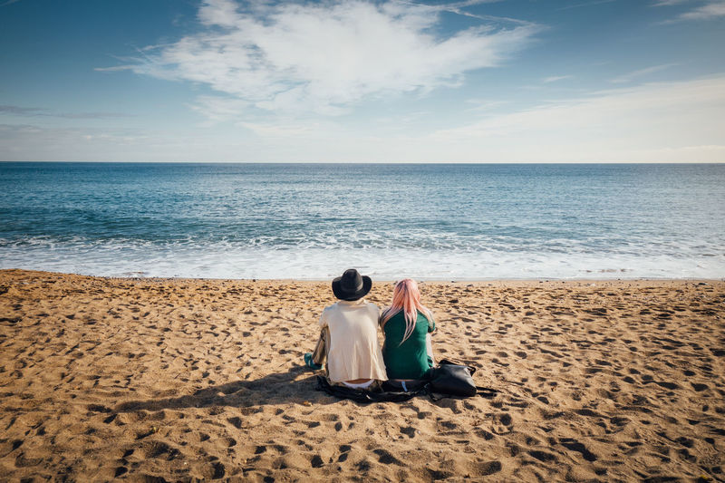 Couple Cowboy Love Beach Beauty In Nature Couple - Relationship Day Full Length Horizon Over Water Nature Outdoors People Punk Real People Rear View Sand Scenics Sea Sitting Sky Togetherness Tranquil Scene Two People Water Young Adult Shades Of Winter