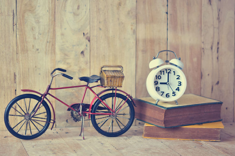 Absence Alarm Clock Bicycle Clock Indoors  Land Vehicle Mode Of Transportation Old Retro Styled Still Life Table Time Transportation Vintage Wall - Building Feature Wheel Wood Wood - Material