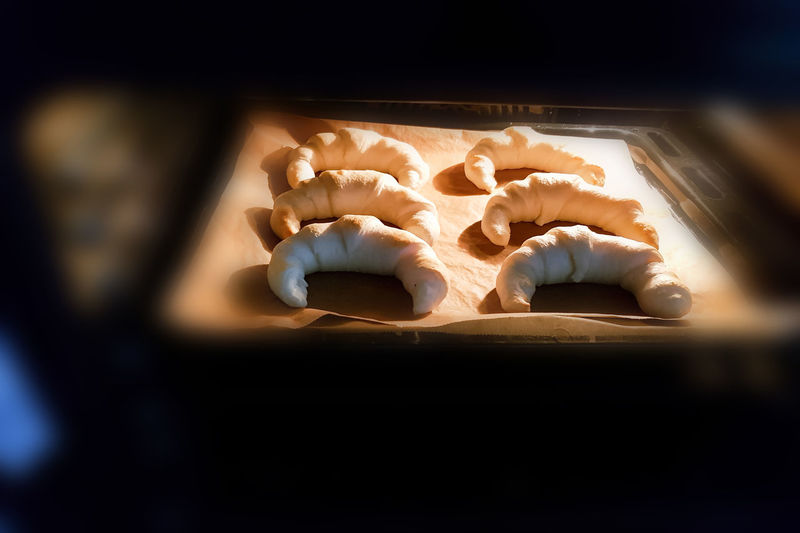 Homemade pastries, croissants in the oven. Indoors  Close-up No People Food Food And Drink Selective Focus Still Life Sweet Food Shape Table Indulgence Oven High Angle View Heat - Temperature Preparation  Sweet Freshness Burning Dessert Design Temptation Baking Sheet #NotYourCliche Love Letter Humanity Meets Technology
