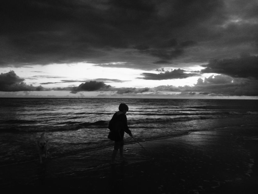 My son on the beach in Denmark in summer 2017 Beach Sky Silhouettes Sunset Sonnenuntergang Gegenlicht Mood Himmel Cloud - Sky Backlight Black And White Friday Nature Dänemark Denmark Blåvand Water Beachphotography Strand Meer Outdoors Blackandwhite Schwarzweiß Scenics Coastline Northsea