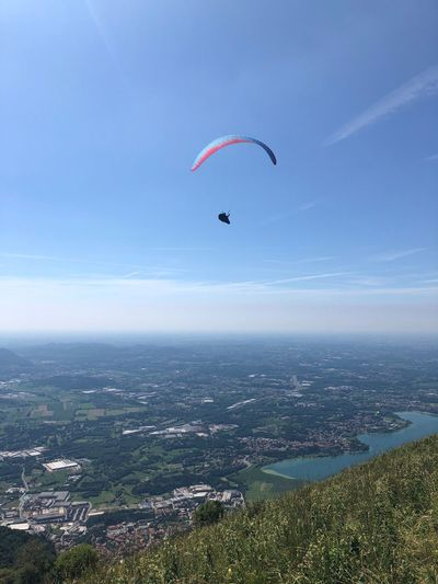 Mountain Adventure Flying Paragliding Sky Parachute Extreme Sports Mid-air Sport Nature Unrecognizable Person Day Beauty In Nature Environment Scenics - Nature One Person Leisure Activity Freedom