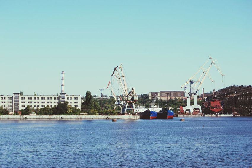 Outdoors Sky Water Rollercoaster Business Finance And Industry Ferris Wheel No People Nature Shipbuilding Yard Shipbuilding Shipyard Ship At Dock River View Riverside Photography Industry In City Industrial Landscapes Industrial Architecture Industrial Photography Industrial Ship Summer Day Calm Water Industrial Decay