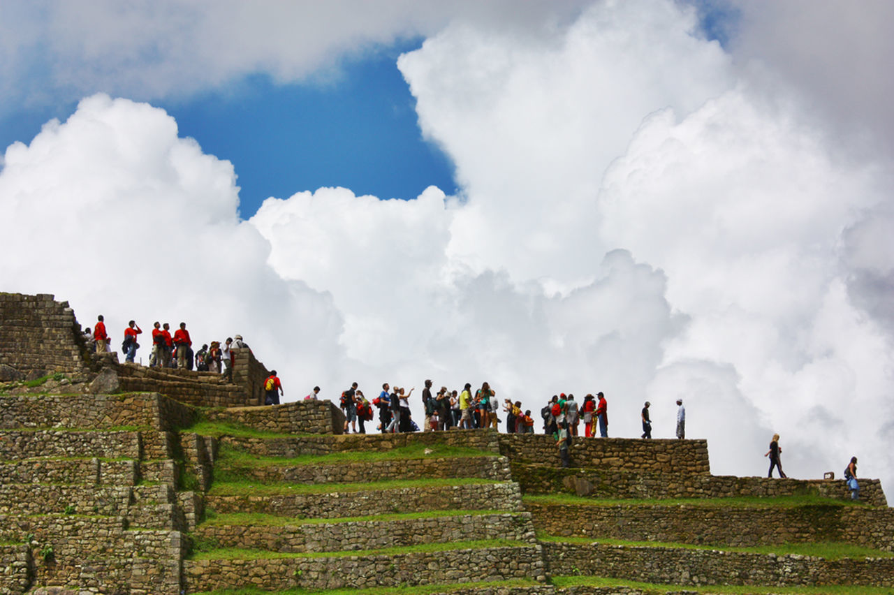 large group of people, real people, sky, men, women, cloud - sky, steps, memorial, history, day, steps and staircases, mixed age range, outdoors, nature, lifestyles, leisure activity, travel destinations, ancient civilization, adult, people