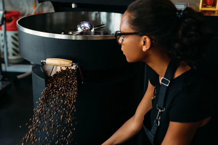 African American Coffee Females Production Quality Raw Small Business Woman Working Barista Cafe Close Up Indoors  Lifestyles One Person Owner Professional Real People Roasting Selective Focus