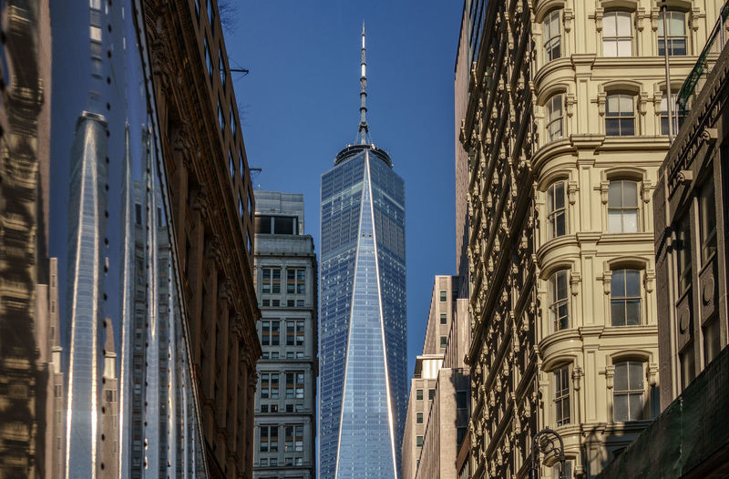 Low angle view on One world trade center Financial District  Built Structure Architecture Building Exterior Building City Tall - High Tower Sky Day No People Travel Destinations Office Building Exterior Skyscraper Low Angle View Clear Sky Modern Outdoors New York NYC One World Trade Center