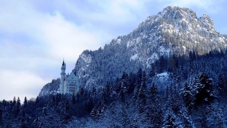 Neuschwanstein a 19th-century Romanesque Revival palace on a rugged hill above the village of Hohenschwangau near Füssen in southwest Bavaria, Germany. Bavaria Castle Neuschwanstein Neuschwanstein Castle Schloss Neuschwanstein Snow ❄ Architecture Beauty In Nature Cloud - Sky Forest Germany Mountain Nature Snow Snowcapped Mountain Winter A New Beginning EyeEmNewHere