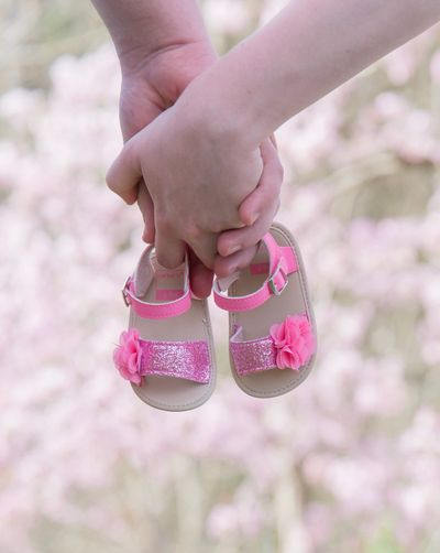 New parents to be Human Body Part Childhood Child One Person Body Part Pink Color Hand Focus On Foreground Offspring Close-up Human Hand Women Girls Shoe Females Low Section Real People Baby Outdoors Day