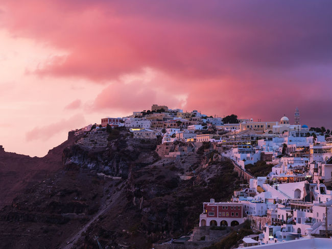 A firey sunset over Thira, Santorini. Olympus Santorini, Greece Tranquility Architecture Beauty In Nature Built Structure Cityscape Cliff Cloud - Sky Dusk Em1 Mk2 Greece Mountain Outdoors Santorini Scenics - Nature Sky Sunset Travel Destinations Week On Eyeem A New Perspective On Life
