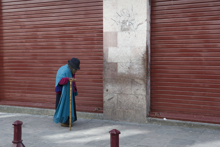 Old woman walking with her cane Architecture Brick Wall Built Structure Closed Copy Space Day Mature Woman Old Old Woman Outdoors Red Shuffling Shutter Stooped Struggle The Street Photographer - 2016 EyeEm Awards Walking Walking Cane Wall