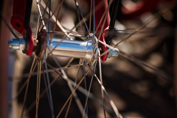 closeup of bicycle wheel Bicycle Close-up Day Focus On Foreground Hub Land Vehicle Metal Mode Of Transportation Nature No People Outdoors Selective Focus Spoke Stationary Tire Transportation Travel Wheel Wire