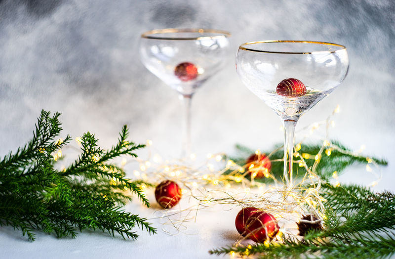 Christmas and new year eve party celebration with champagne glasses and lights