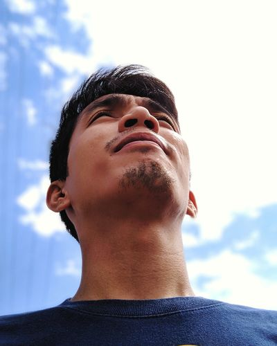 Close-Up Of Smiling Man Against Sky