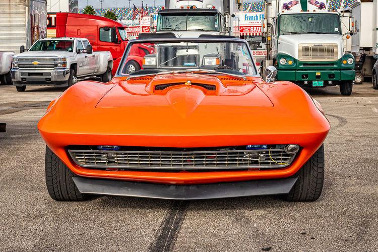 Close-up of orange car on road