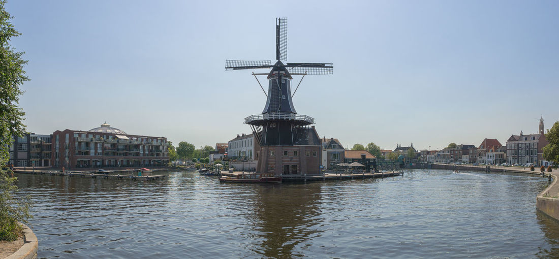 Haarlem Netherlands Windmill Architecture Building Building Exterior Built Structure City Day Dutch Nature Nautical Vessel No People Outdoors Reflection River Sky Transportation Travel Travel Destinations Water Waterfront