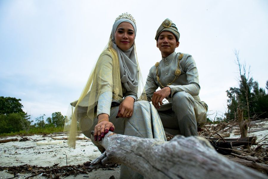 MALAY WEDDING - OUTDOOR SESSION Beach Malaywedding Sitting Two People Togetherness Smiling Sky Day Low Angle View