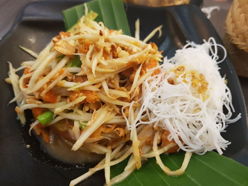Papaya Salad Papaya Papaya Salad Thai Food Thaifood Thai Cuisine Thai Salad Spicy Food Spicy Thai Food Spicy Salad Decoration Rice Noodle  Banana Leaf Chili  No People Food Food And Drink Indoors  Close-up Healthy Eating Ready-to-eat Freshness Day