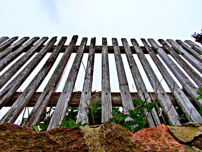 Low Angle View No People Day Wood - Material Barrier Boundary Fence Outdoors Security Safety Pattern