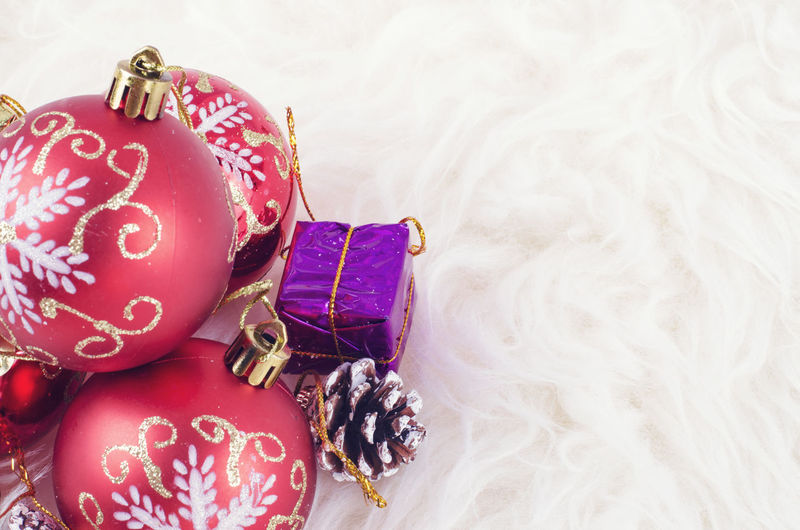 Closeup background image of Christmas festival decoration with red ornament ball Art And Craft Celebration Christmas Christmas Decoration Christmas Ornament Close-up Decoration Design Event Floral Pattern High Angle View Holiday Indoors  No People Pattern Pink Color Red Still Life Textile
