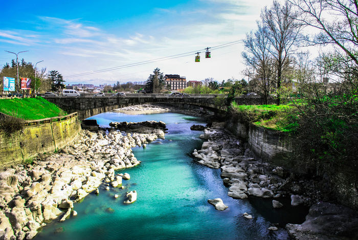 Spring in Kutaisi Architecture Beauty In Nature Bridge Bridge - Man Made Structure Building Exterior Built Structure Canal City Colors Connection Day Georgia Kutaisi Nature Nature Nautical Vessel No People Outdoors Ropeway Sky Spring Transportation Travel Destinations Tree Water