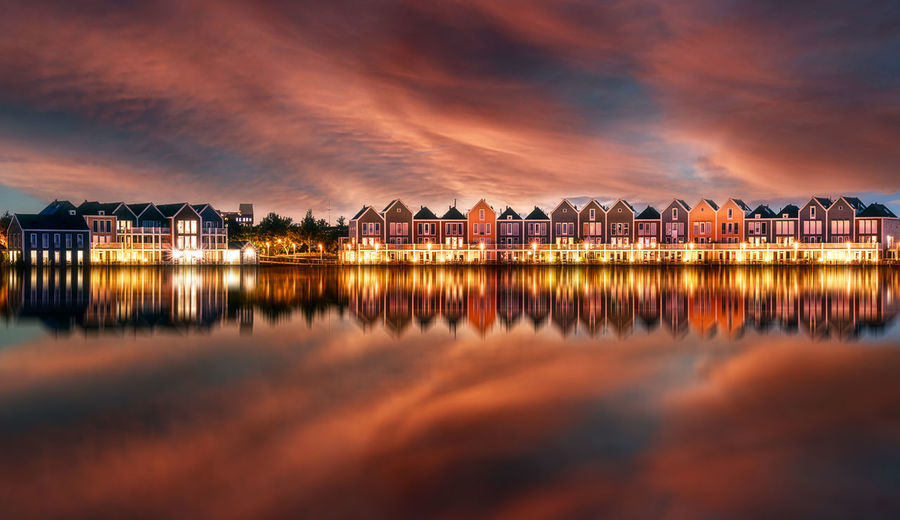Rainbow houses - houten. netherlands. this very iconic floating houses are really one of a kind.