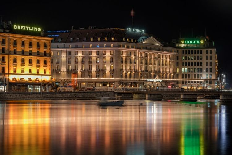 Reflections In The Water Citiscape  Genève / Geneva / Genf Long Exposure Ginebra (Suiza) Hotel Switzerland Built Structure Building Exterior Architecture Illuminated Night Reflection City Water Travel Destinations Waterfront Travel Tourism No People River Nightlife