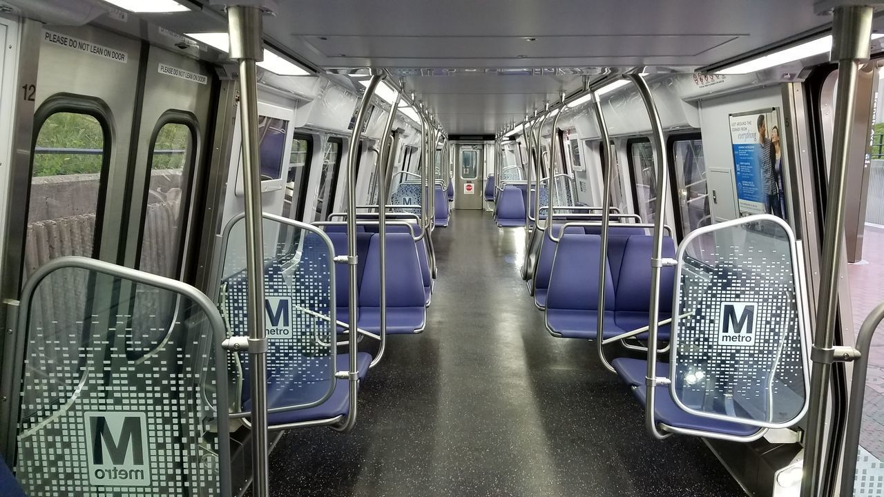 EMPTY SEATS IN TRAIN AT SUBWAY STATION