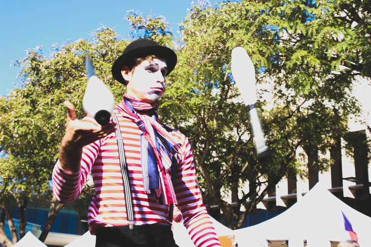 Juggler performing in the street Adult Arts Culture And Entertainment Day Face Paint French Hat Juggler Juggling Leisure Activity Lifestyles Low Angle View Masked One Person Outdoors Performance Performer  Real People Standing Street Entertainment My Year My View