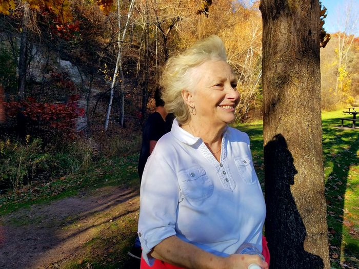 Grandmother walking through the park Second Acts Smiling Happiness Cheerful Fun Motion Enjoyment Outdoors Joy Path Park One Person Day Tree People Standing Portrait Nature Adults Only Saint Paul Fall Foliage Grandma Grandmother Battle Creek Regional Park